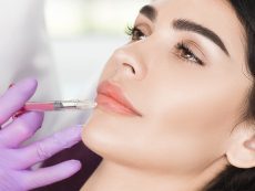 woman having lip injections, procedure lip augmentationwoman having lip injections, a prick of a syringe for the beauty lips. lip augmentation